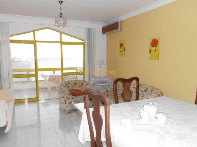 living room and balcony over the beach of quarteira
